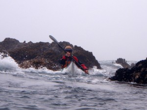 Jon threads his sea kayak through a labrynth of rock gardens.